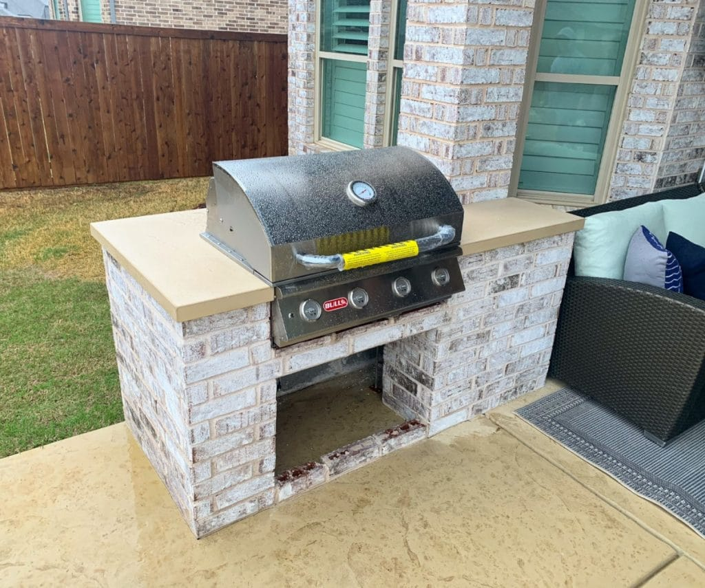matching concrete countertops with outdoor concrete floors for an outdoor kitchen