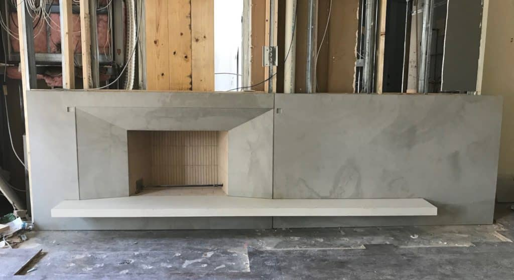 16' long Fireplace Surround and Wall Panels with 12' Floating Hearth for a condo in Dallas, Tx