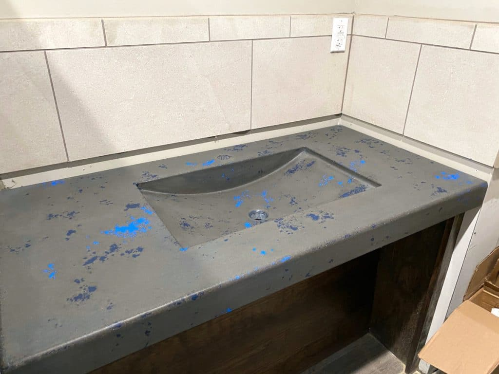 Grey Concrete Vanity with Blue Accents