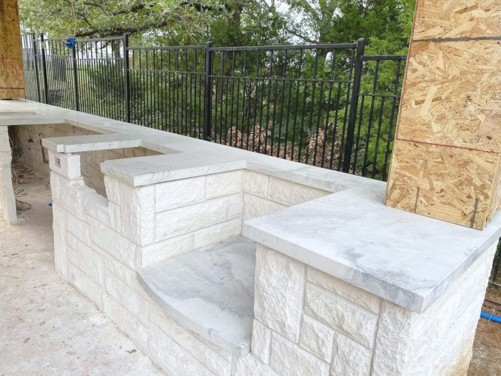 Our White Marbled Concrete Countertops Look Great on top of the White Masonry!
