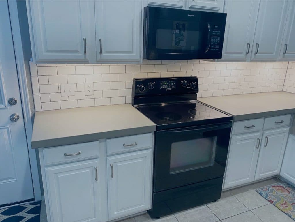 "2"" Thick Light Grey Concrete Kitchen Countertops Paired with White Subway Tiles"