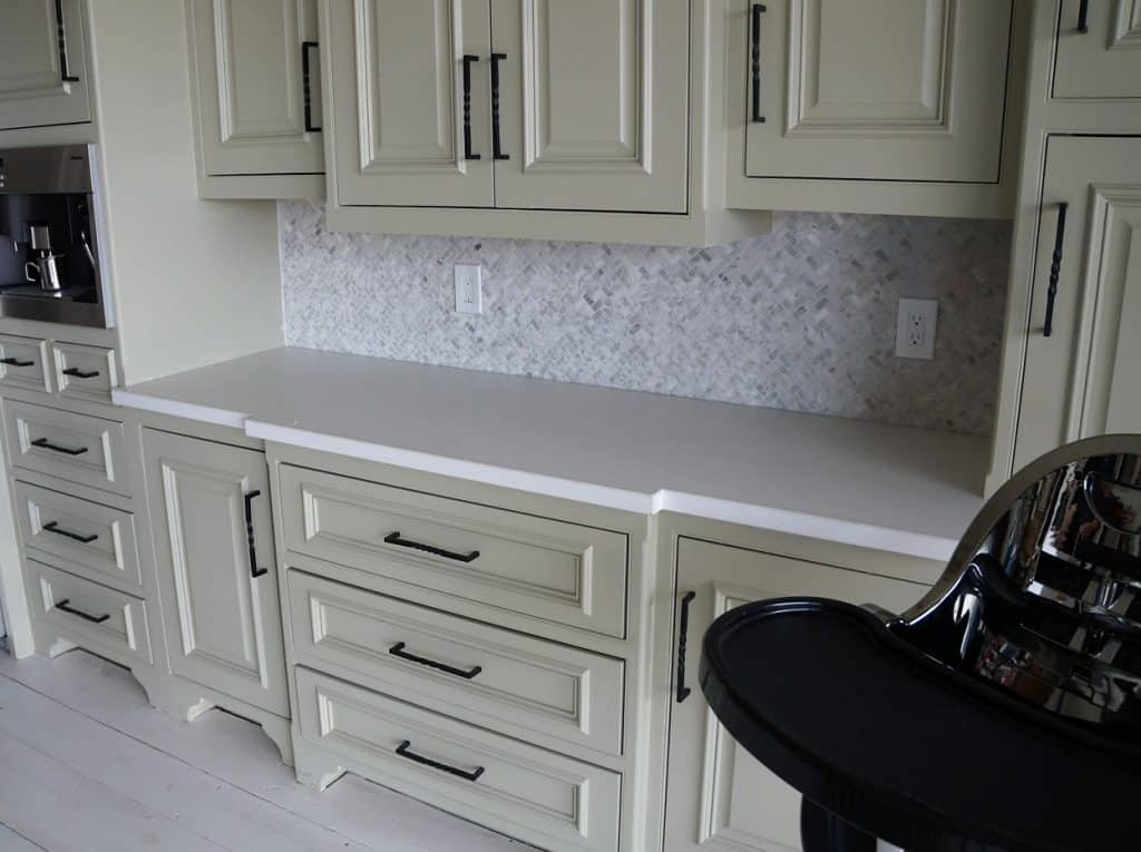 This is a large kitchen with all white concrete countertops for a ranch house in Celina, Tx