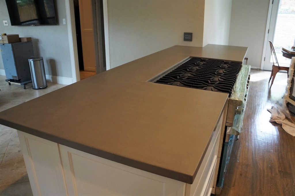Grey concrete countertops looking great with the white cabinets and black accents.