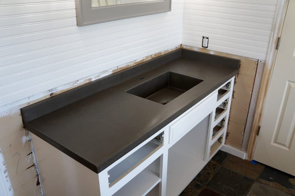 "Concrete Countertops with integrated 20""x12"" square sink installed in a home in Collinsville, Tx."