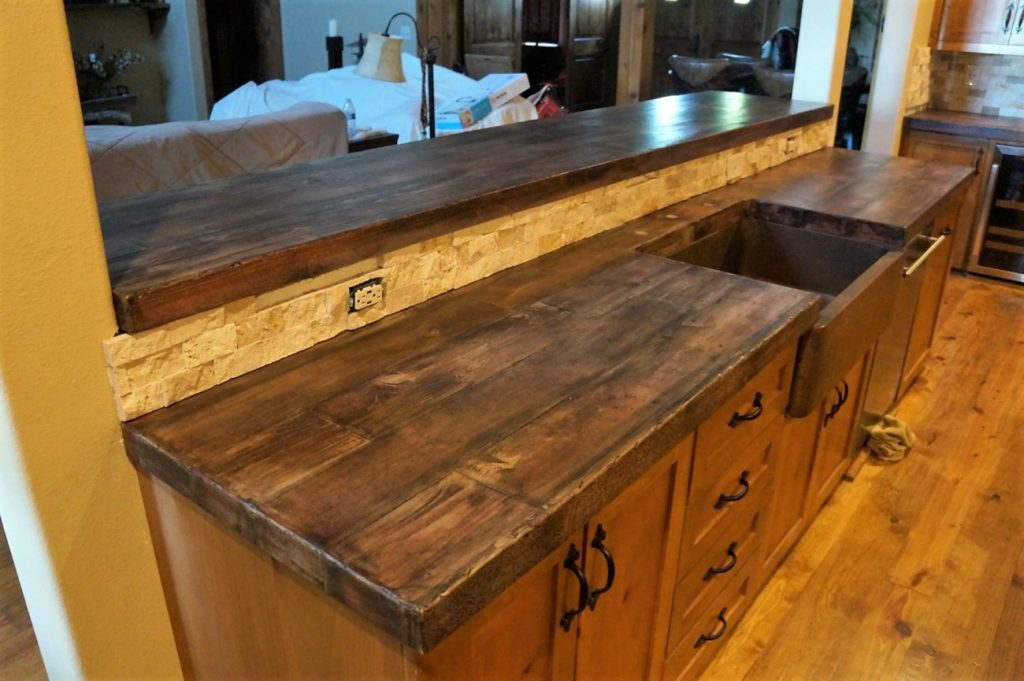 With this wood look, we were able to make the bar countertop 11' long.