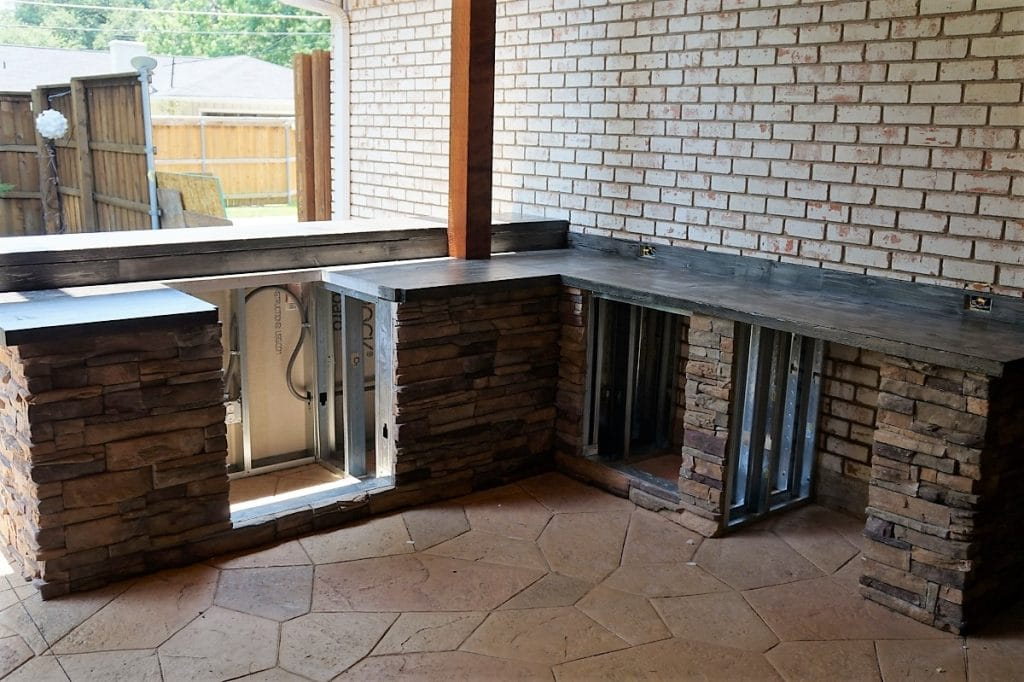 Large outdoor kitchen with our custom wood style concrete countertops.