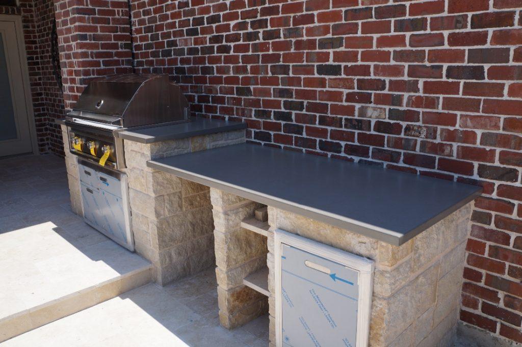Grey Concrete Coutertops for a Elderado Custom Pools Outdoor Kitchen