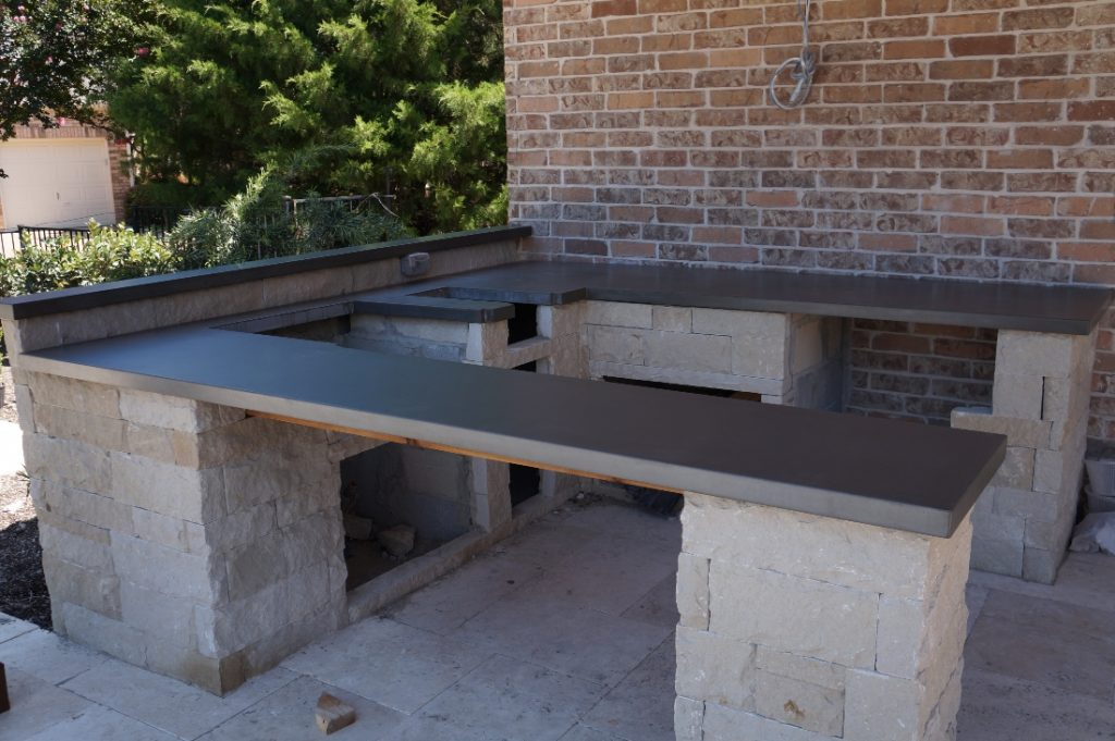 Grey Concrete Countertops for a Hauk Custom Pools Outdoor Kitchen