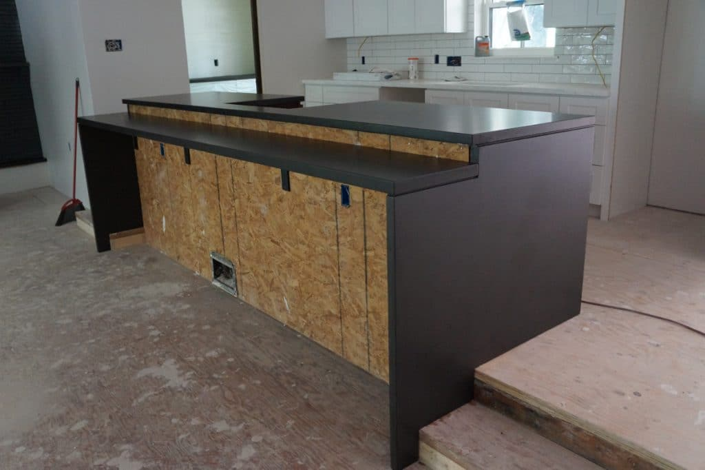 Multi Level Dark Grey Concrete Countertops with Waterfall Panels