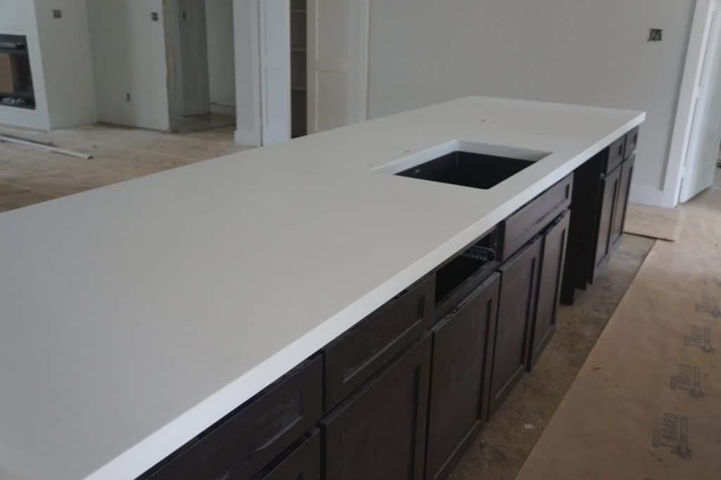 Large White Concrete Island And Kitchen Countertops