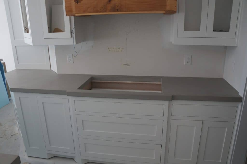 Beautiful open kitchen with our light grey concrete countertops