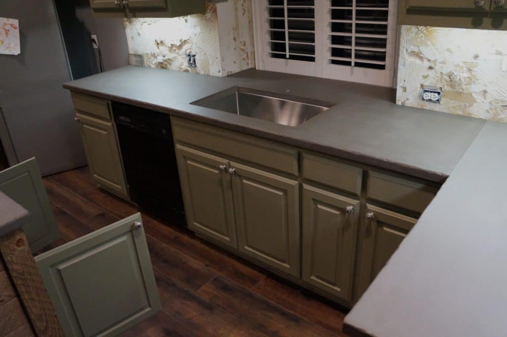 Grey concrete countertops wth our distressed edge.