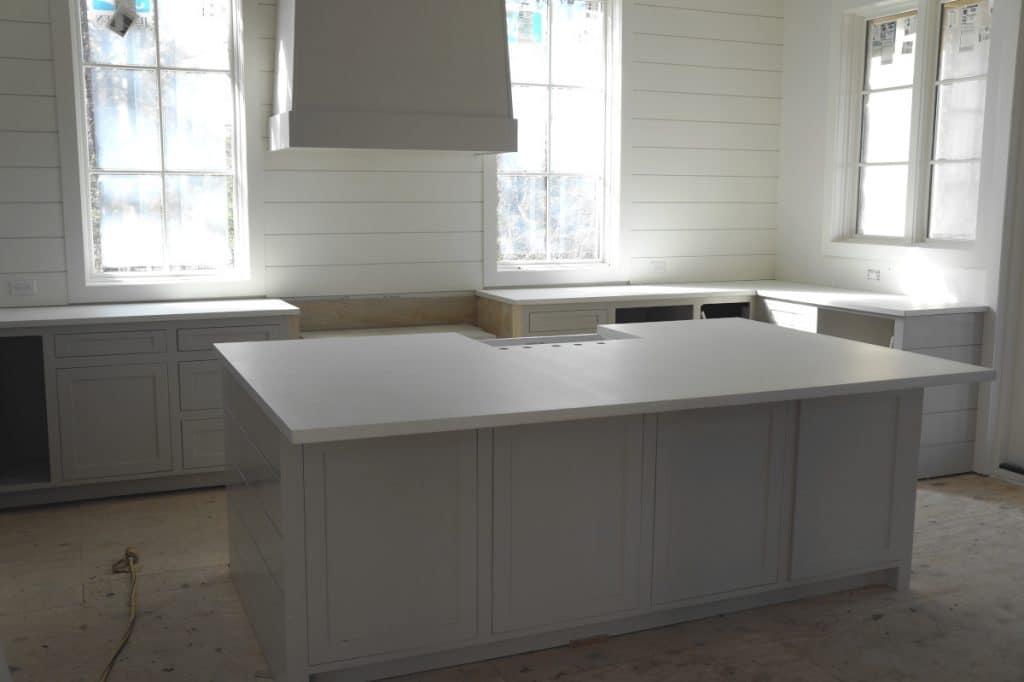 Bright, open kitchen with all white concrete countertops