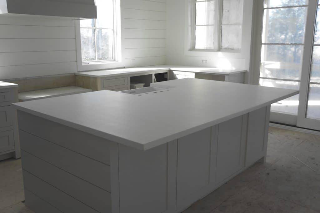 White Concrete Kitchen Countertops on White Cabinetry
