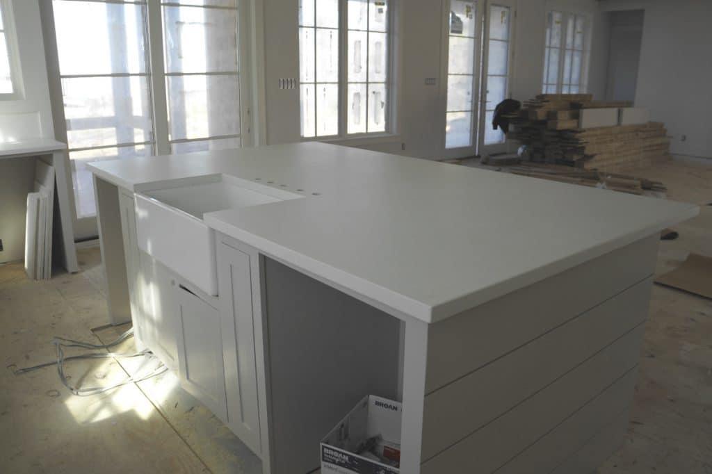 White Concrete Kitchen Countertops with White Farm Sink
