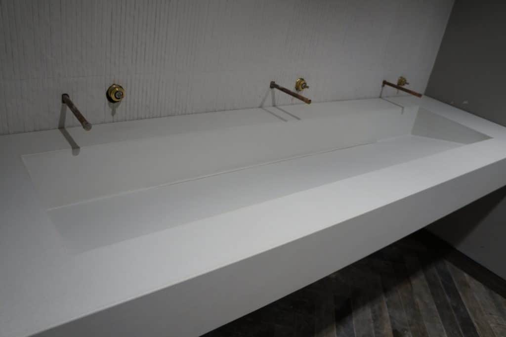Large White Concrete Floating Vanity with Slot Drain Ramp sink