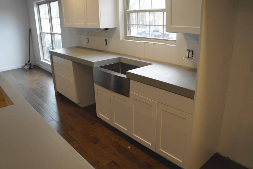 Thick Light Grey Concrete Countertops with Stainless Steel Sink