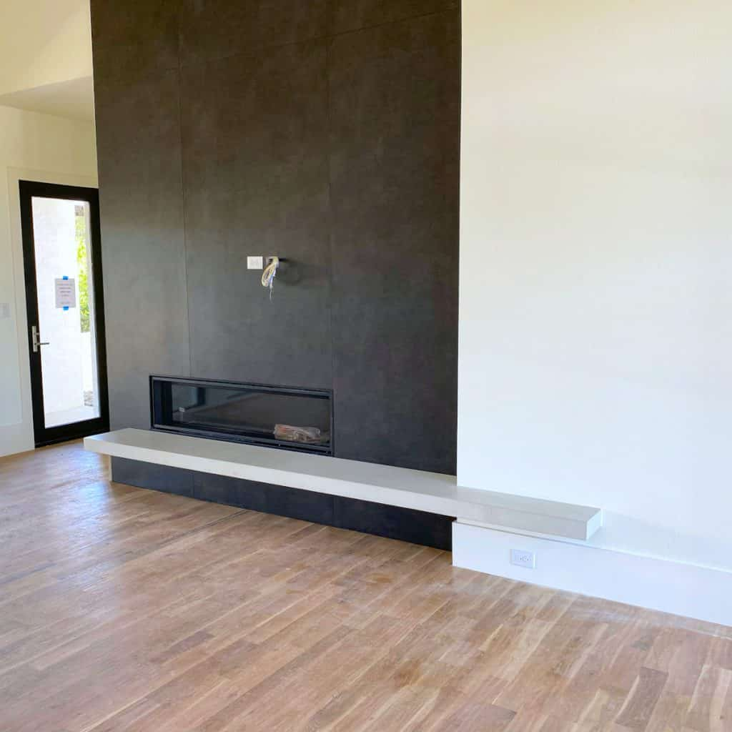 A Beautiful Light Grey Floating Concrete Heath That Will For Sure Be The Focal Point of This Living Room!