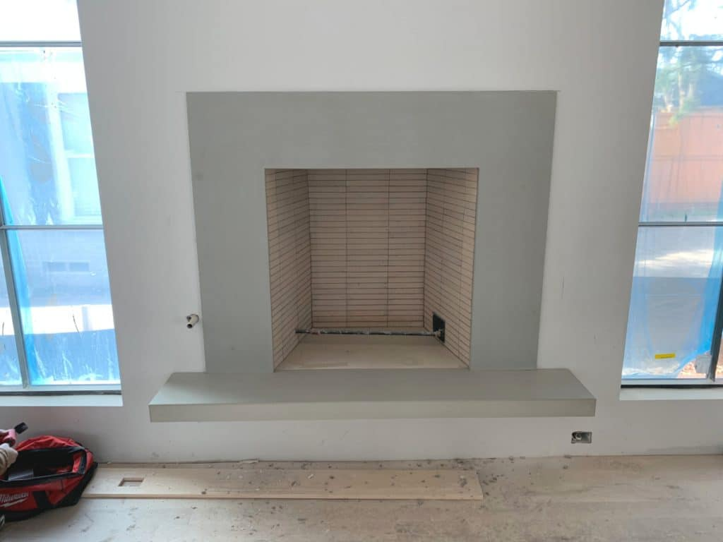Sleek Looking Light Grey Concrete Fireplace Surround and Floating Hearth