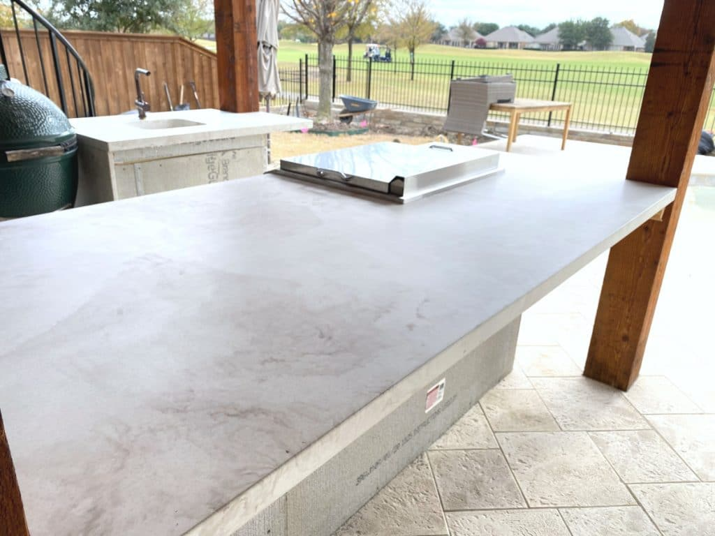 One of a Kind White and Taupe Marbled Concrete Island for an Outdoor Kitchen