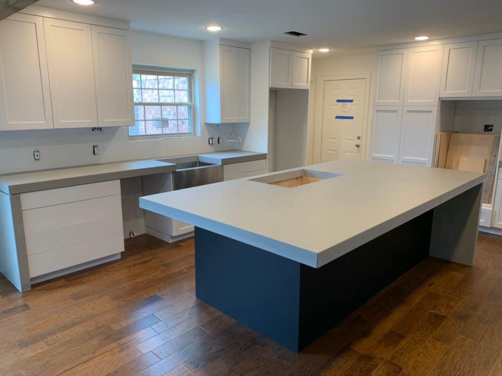 Thick Light Grey Concrete Kitchen Countertops on Blue Cabinets