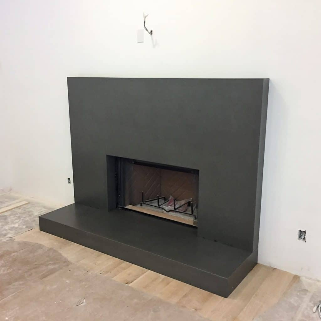 Gray Concrete Fireplace Surround with Hearth installed in Dallas, Texas