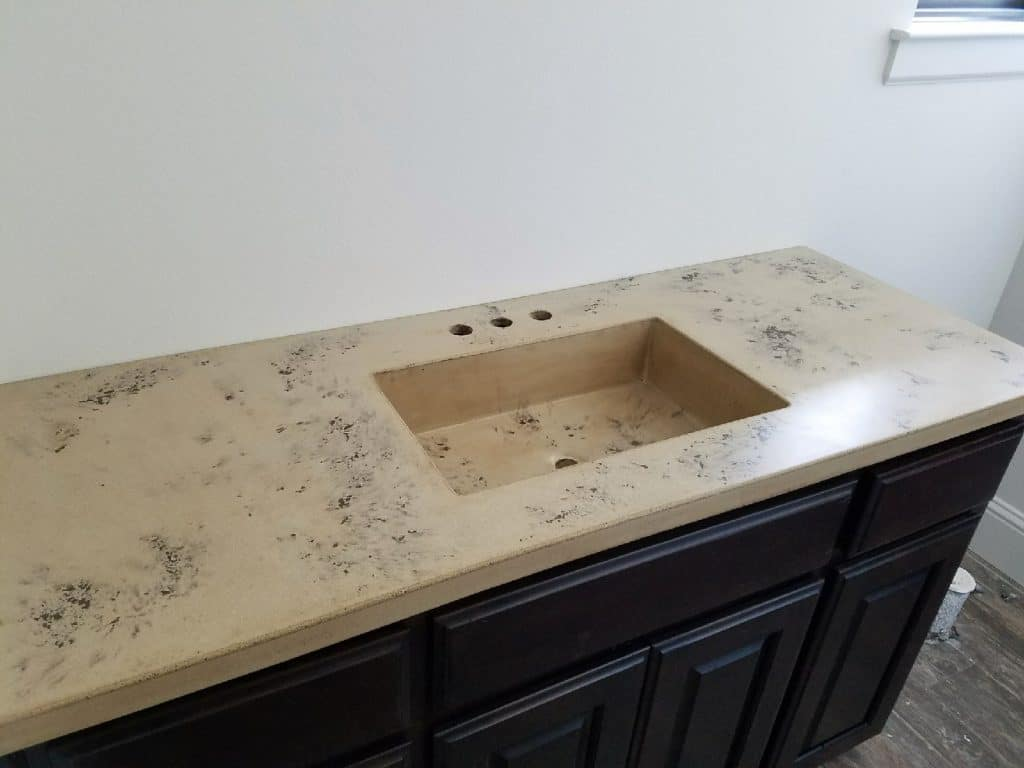 "Concrete Countertop with our 20""x12"" concrete sink. This countertop has a brown fill scattered randomly across the top. This went into a home in Heath, Tx."