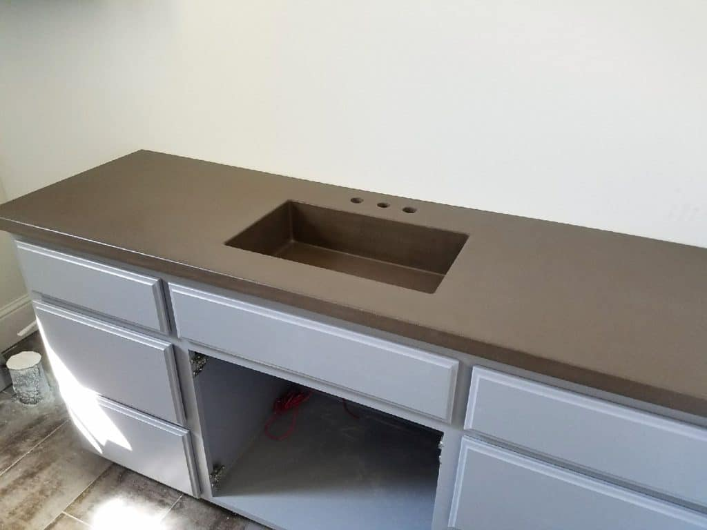 A Nice Solid Brown Concrete Countertop with Integrated Concrete sink. This was also for the home in Heath, Tx