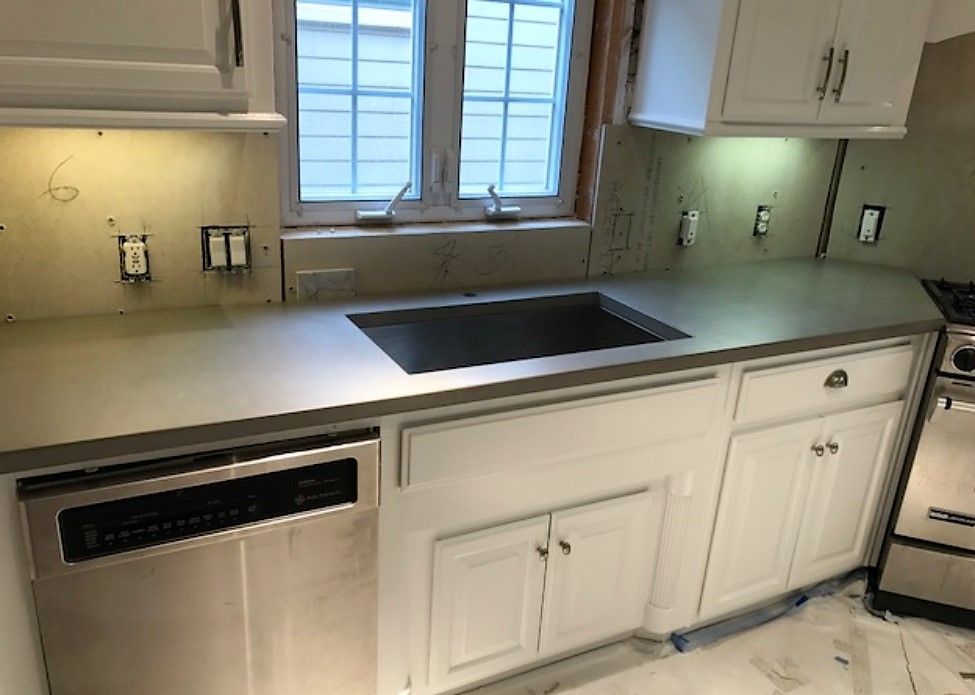 Nice grey concrete countertops is a townhouse in Dallas, Tx.