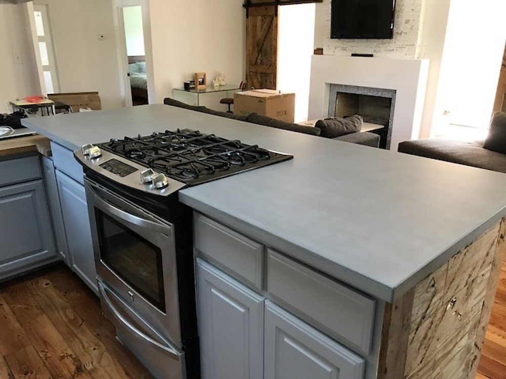 This client had us remove the granite countertop she had to make way for this beautiful grey concrete countertop.