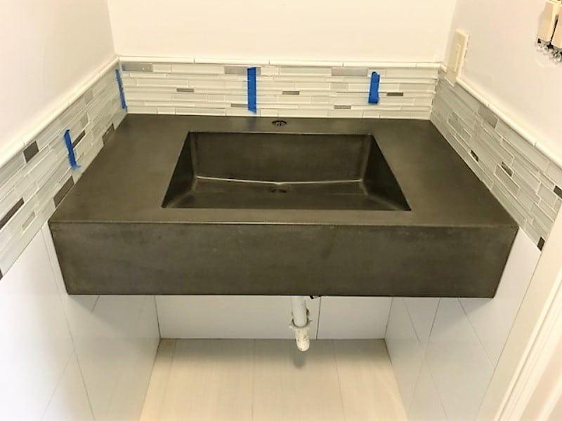 Dark grey floating concrete ramp sink installed in Denton, Tx