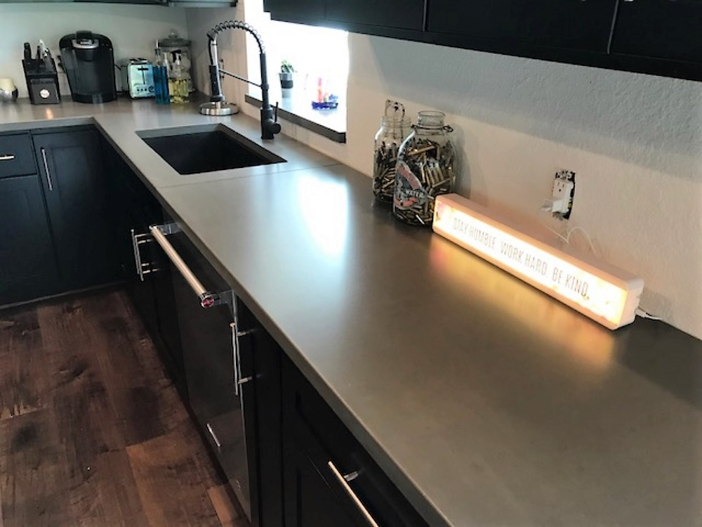 These are some updated pictures of the concrete countertops we installed in a home in Double Oak, Tx
