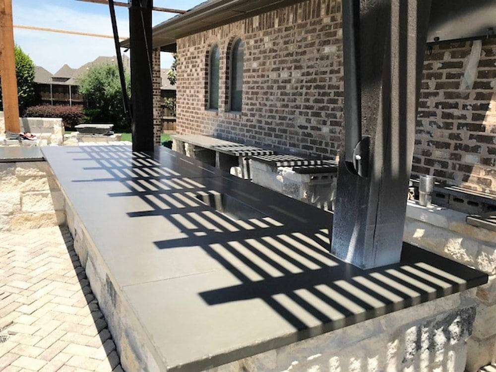 Very large outdoor kitchen with our distressed edge gray concrete countertops.