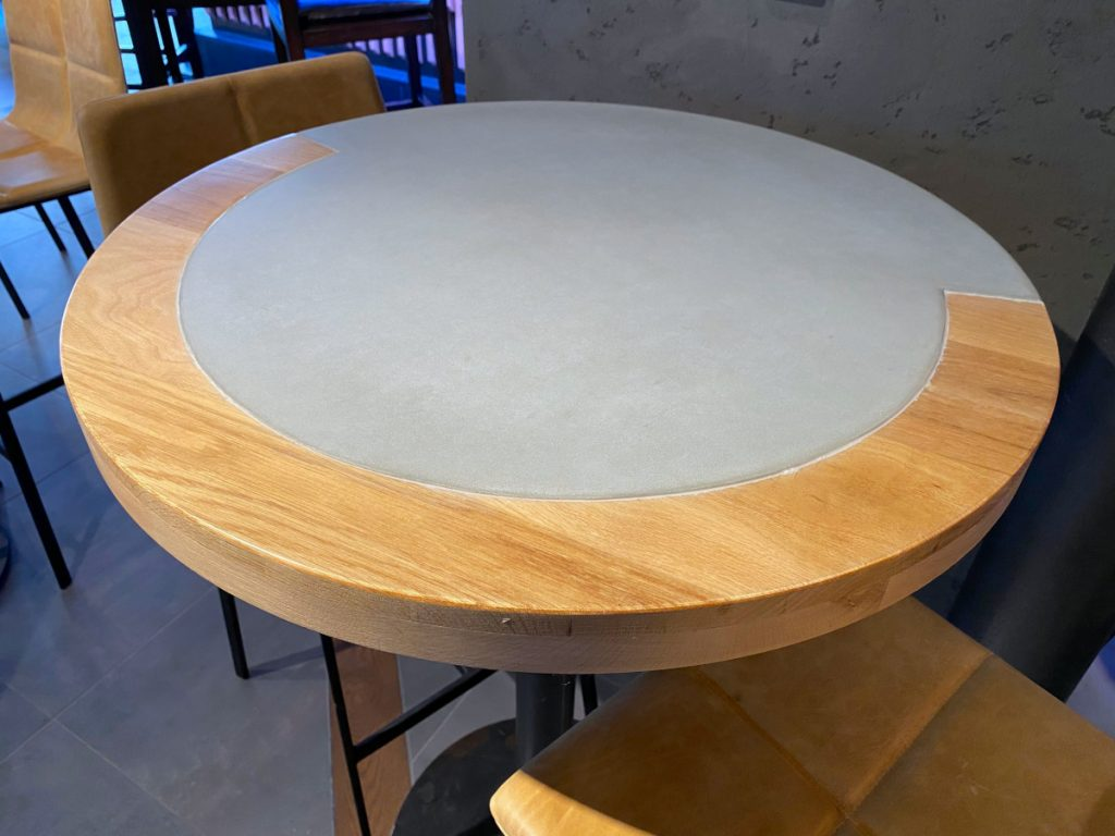 Round Seating Table Made of Concrete and Wood