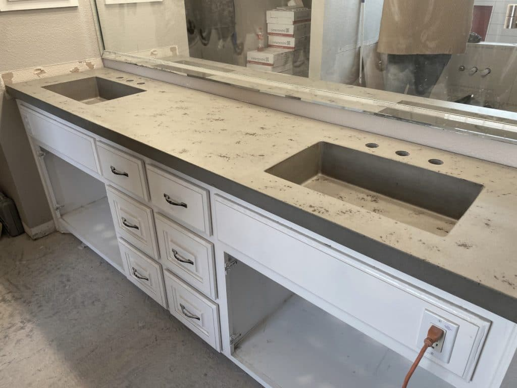 "Grey Concrete Countertop with Brown Accents with Two 20"" x 12"" Integral Sinks"