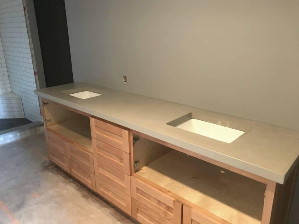 Light Grey Concrete Vanity with double undermount sinks.