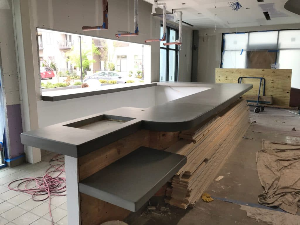 Grey Concrete Bar Top With Curved Corners For Fish City Grill Restaurant