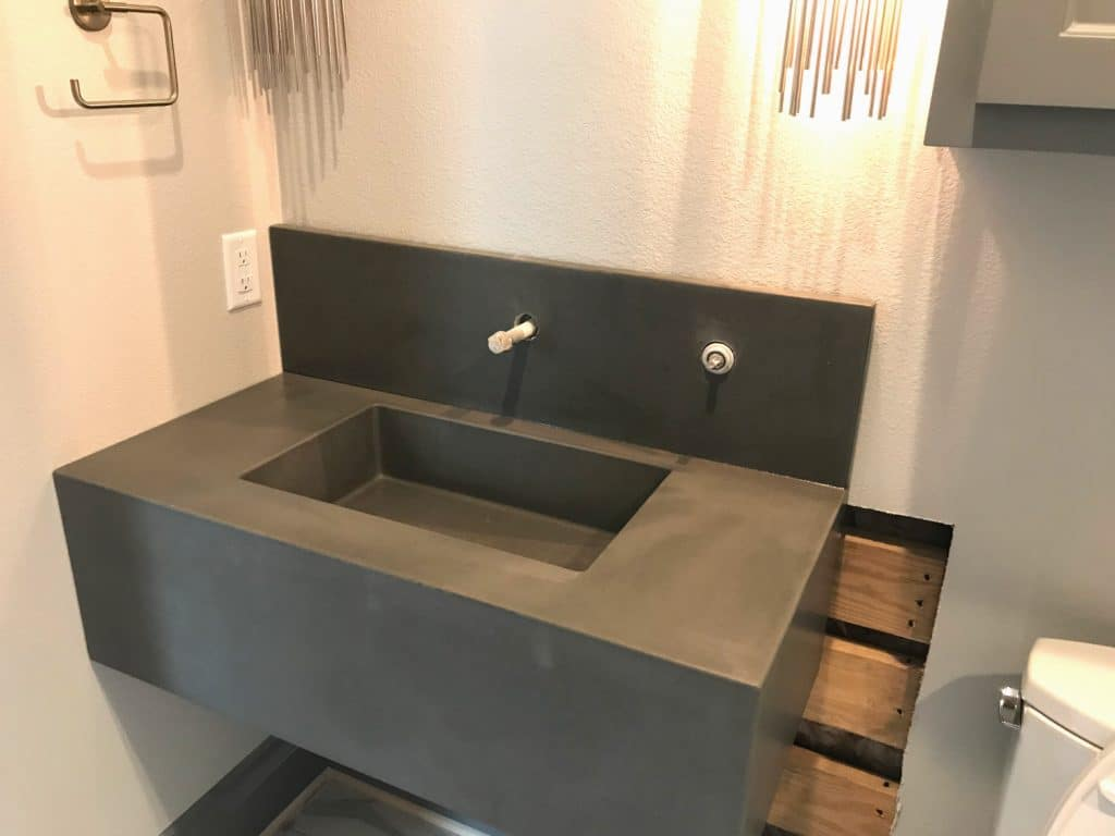 Grey Concrete Floating Vanity with integral sink and matching backsplash