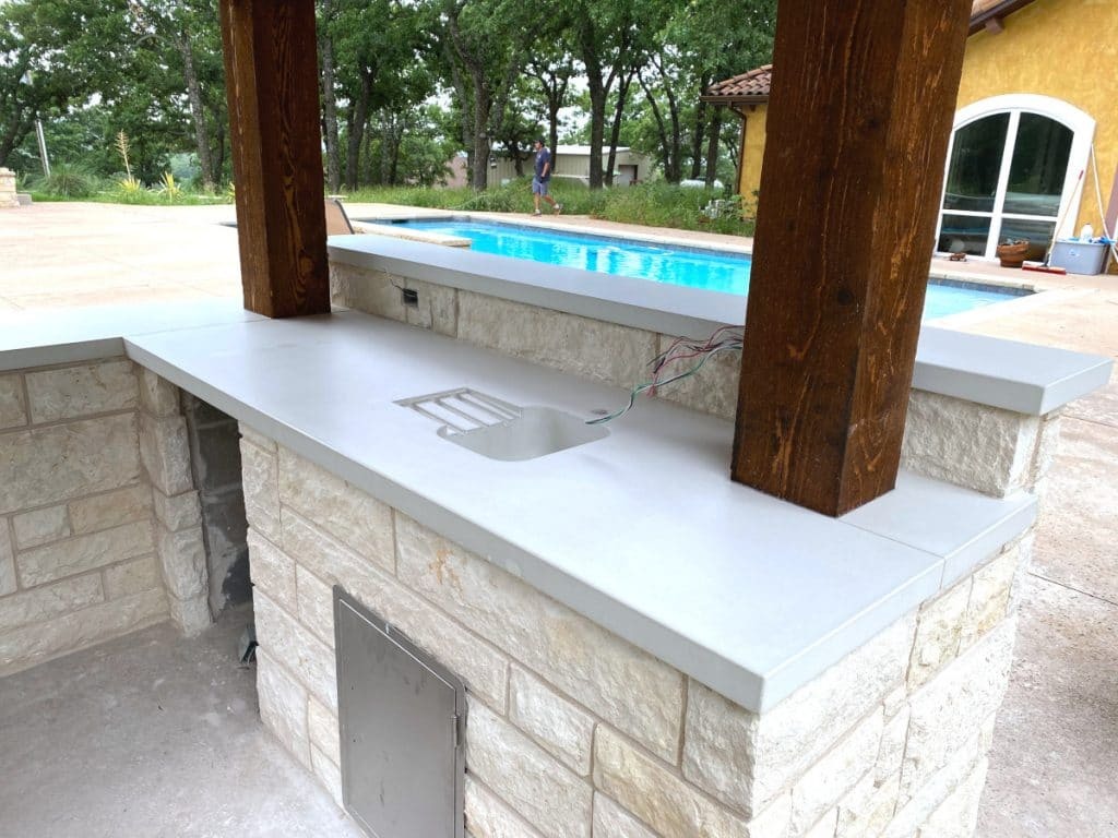 We integrated a drainboard into the countertop to go with the integral concrete bar sink!