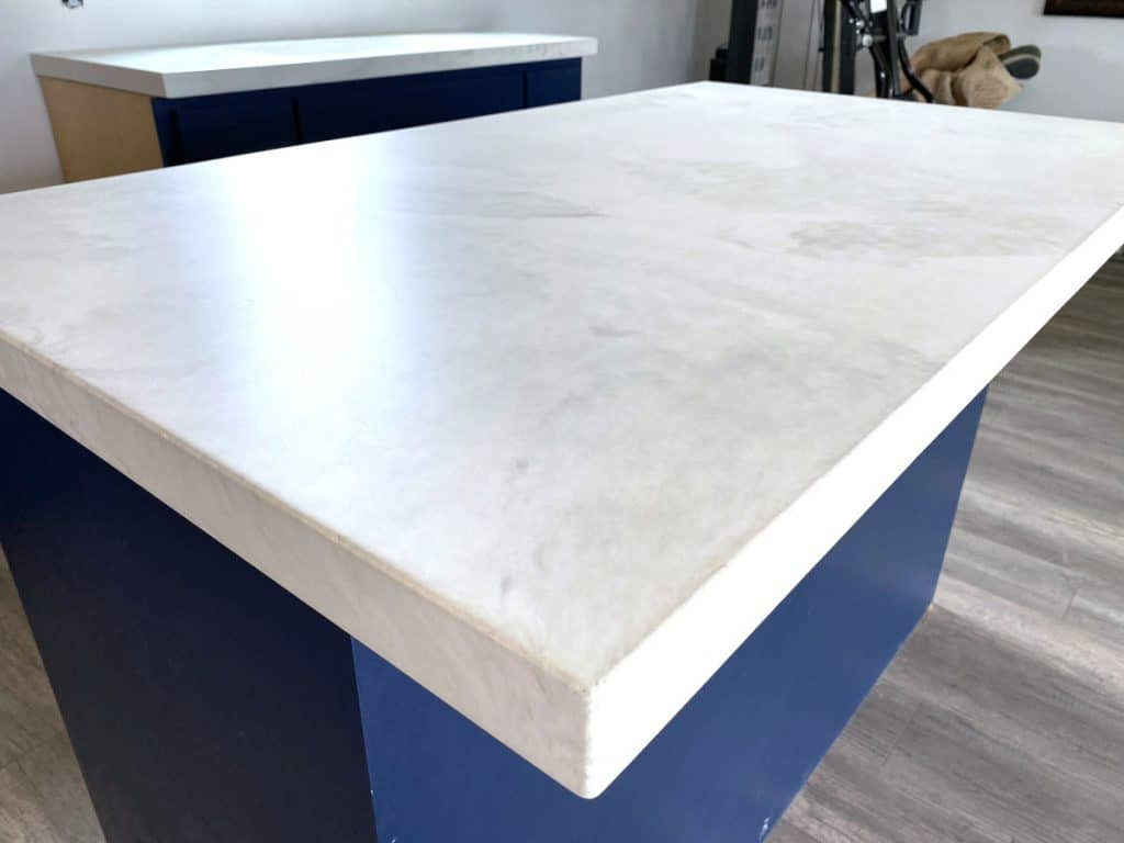 Gorgeous White Marbled Concrete sat on top of Royal Blue Cabinetry