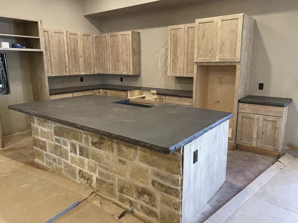 Full Kitchen View of These Dark Grey Concrete Countertops With Our Custom Chiseled Edge