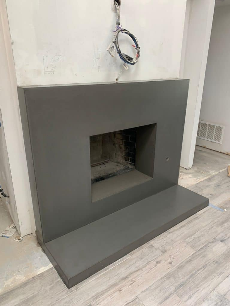Large Plain Grey Concrete Fireplace Surround and Hearth Installed for a Home in Dallas