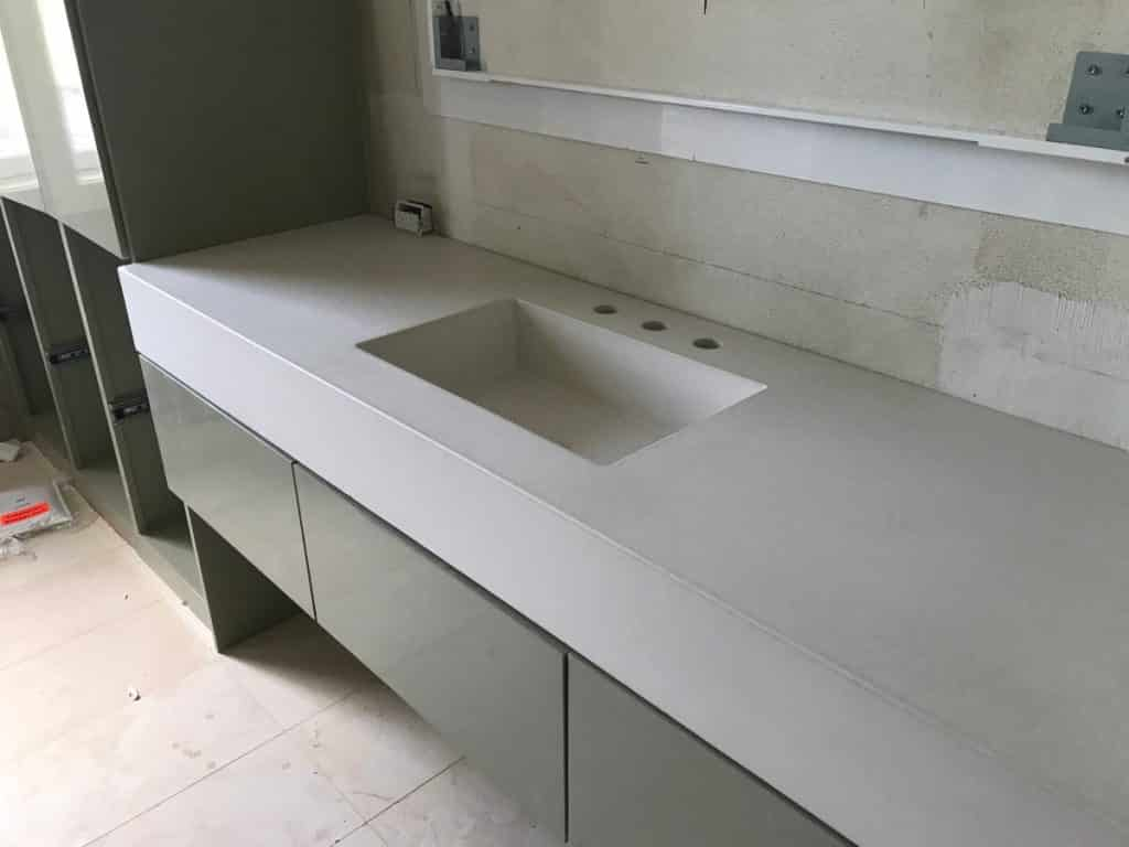 "Gorgeous bone white vanity with our 20"" x 12"" integral sink"