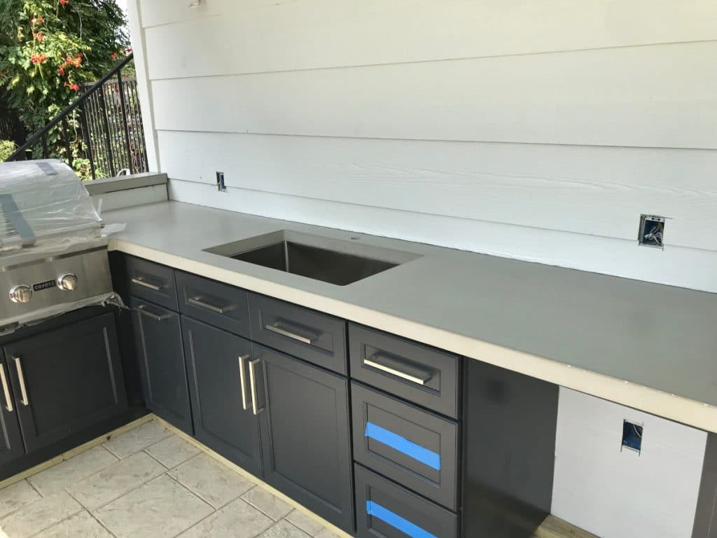 Stainless steel appliances go great with this light grey concrete