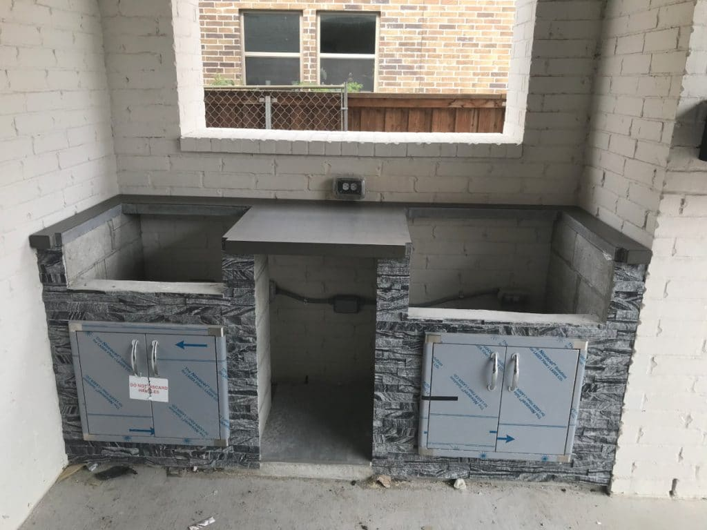 Grill and burner portion countertops of a Hauk Custom Pools outdoor kitchen