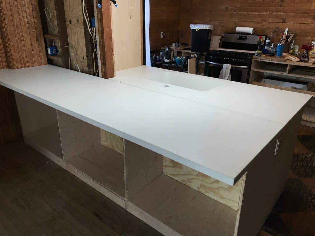 Pearly white concrete countertops with an integral kitchen sink for a home in Wylie, Tx
