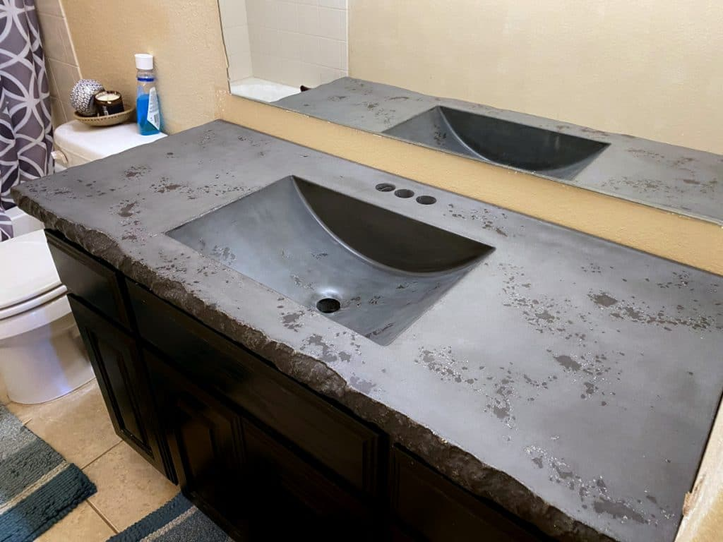 Dark Grey and Black Concrete Vanity with Integral Barrel Sink and Custom Chiseled Edge