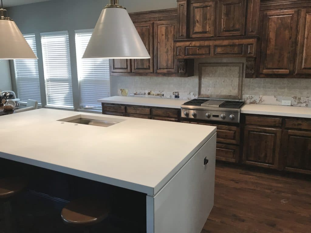 These countertops were made to replace some outdated granite countertops. The new white concrete countertops really brightened up the kitchen and give it a more modern look and feel.