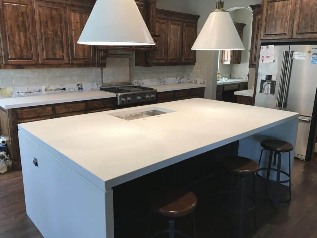 White Concrete Kitchen Countertops with Waterfall Panels
