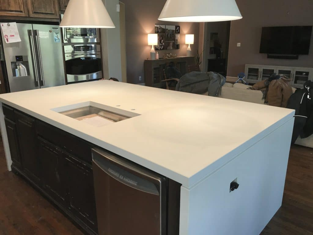 Beautiful 10' white concrete island with waterfall panels installed in a home in Frisco, Tx